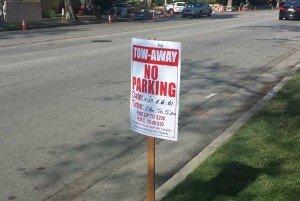 A temporary no parking sign