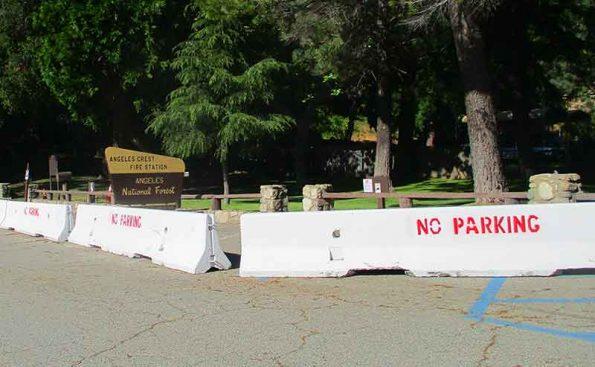 Sement barricades blocking aparking lot